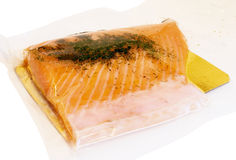 Salmon in the package. Salmon fish in vacuum packing on golden tray Royalty Free Stock Image