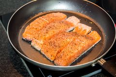 Salmon in pan. Salmon in a pan background Royalty Free Stock Photography