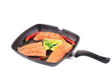 Salmon in pan with pepper. Stock Photo