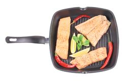 Salmon in pan with pepper. Royalty Free Stock Photo