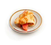 Salmon with  pancake on plate. Stock Image