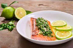 Salmon with parsley sauce Stock Photos