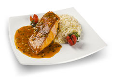 Salmon with passion fruit sauce.  royalty free stock photos