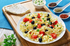 Salmon pasta  black olive salad on plate Stock Photography