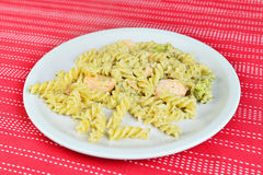 Salmon with pasta, broccoli and cream sauce and parmesan cheese Stock Photo