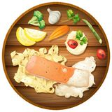Salmon and Pasta Cream Sauce on Wooden Board Stock Images