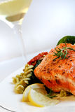 Salmon, Pasta Salad and White Wine. A grilled fillet of atlantic salmon, with fresh pasta salad and a glass of white wine royalty free stock images