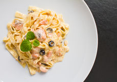 Salmon Pasta. Shot with creamy sauce and olives on white plate. See more italian and healthy Royalty Free Stock Photos