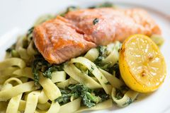 Salmon with pasta and spinach Stock Photo