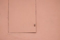 Salmon pastel color painted hatch and wall Stock Image