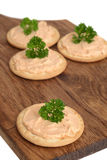 Salmon pate crackers on cutting board Royalty Free Stock Photo