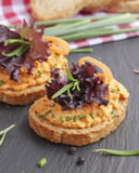 Salmon pate on toast rye bread. Several sandwiches with salmon pate, fish bruschetta Royalty Free Stock Image