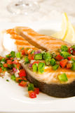 Salmon with pepper salsa stock photography