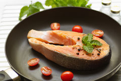 Salmon with  pepper,tomato and mint leaf Stock Photo