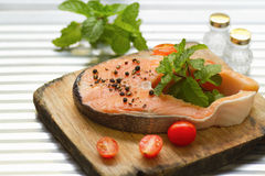 Salmon with  pepper,tomato and mint leaf Royalty Free Stock Photos