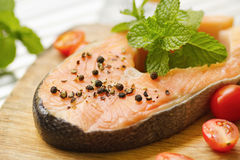 Salmon with  pepper,tomato and mint leaf Royalty Free Stock Photo