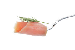 Salmon piece with dill on a fork isolated on white Royalty Free Stock Image