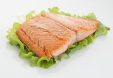 Salmon piece. Piece of steamed salmon and lettuce stock photos