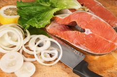 Salmon pieces on cooking desk Royalty Free Stock Image