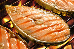 Salmon. Pieces of salmon on flaming grill Stock Photo