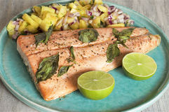 Salmon with pineapple salsa and lime. Food & Dishes for Restaurants, Cuisine of the peoples of the world, Healthy Recipes Stock Photo