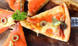 Salmon Pizza is cut into ready to eat. Salmon Pizza is cut into ready to eat Royalty Free Stock Photography