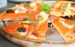 Salmon Pizza is cut into ready to eat. Salmon Pizza is cut into ready to eat Stock Photo