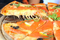Salmon pizza dough crisp eat. Salmon Pizza great Tray is cut into ready to eat Stock Photos