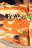 Salmon pizza that looks appetizing. Salmon Pizza great Tray is cut into ready to eat Royalty Free Stock Image