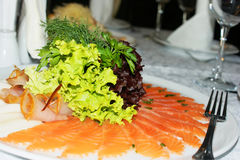Salmon on a plate. Cold appetizer Stock Image
