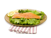 Salmon on a plate with lemons Royalty Free Stock Photography