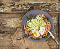 salmon with Poached eggs on salad Stock Photography