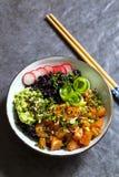 Salmon poke dish with black rice Stock Photography