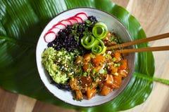 Salmon poke dish with black rice Royalty Free Stock Photos