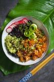 Salmon poke dish with black rice Stock Images