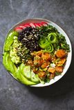 Salmon poke dish with black rice
