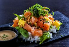 Salmon poke served on a slate royalty free stock images