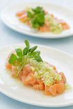 Salmon Poke. Topped with a green onion sauce Stock Images