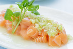 Salmon Poke. Topped with a green onion sauce Royalty Free Stock Photography