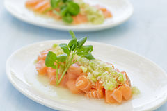 Salmon Poke. Topped with a green onion sauce Stock Image