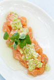 Salmon Poke. Topped with a green onion sauce Stock Photography