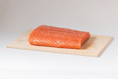 Salmon. Portion of fresh Atlantic salmon on wooden chopping board Stock Photo