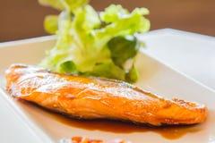 Salmon pour with teriyaki sauce. Royalty Free Stock Image