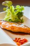 Salmon pour with teriyaki sauce. Stock Image
