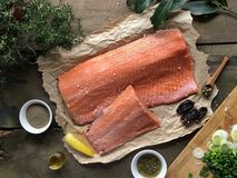 Salmon and props on rustic table Ingredients royalty free stock photography