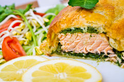 Salmon in puff pastry. Traditional salmon in puff pastry with spinach Stock Photos