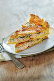 Salmon quiche with spinach. Close up Stock Image