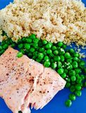 Salmon quinoa and peas Stock Photos