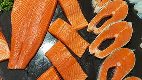 Salmon. Raw salmon fillet on crushed ice black background Stock Image