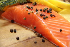 Salmon raw lemon. Delicious appetizing Stock Photos